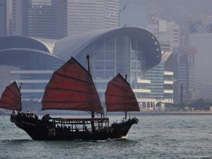 Sightseeing Junk on Victoria Harbour with Hong Kong Convention and Exhibition Centre in Background by Manfred Gottschalk