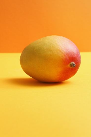 Mango on Coloured Background-Kr?ger and Gross-Photographic Print