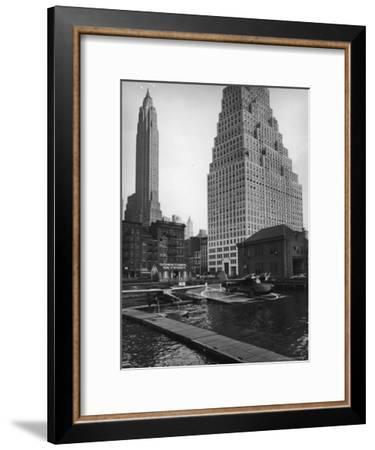 Manhattan's East River Downtown Skyport with Grumman and Fairchild Amphibious Planes-Margaret Bourke-White-Framed Premium Photographic Print