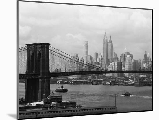 Manhattan Skyline And Brooklyn Bridge-Bettmann-Mounted Photographic Print