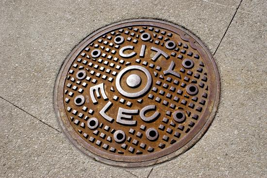 Manhole Cover In Chicago-Mark Williamson-Photographic Print