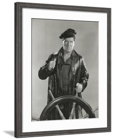 Manning the Wheel--Framed Photo