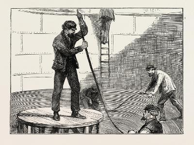 Manufacturing an Electric Telegraph Cable: Coiling Down the Cable in the Tank, 1873--Giclee Print