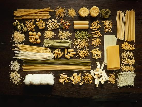 Many Different Types of Pasta on Dark Wooden Background-Walter Cimbal-Photographic Print