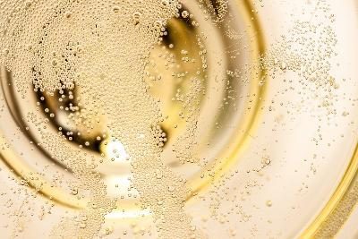 Many Tiny Bubbles in a Champagne Glass- unpict-Photographic Print