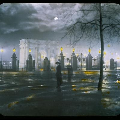 Marble Arch by Night - a Figure Standing in Front of the Park Gates--Photographic Print