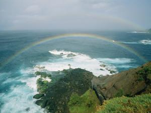 A Double Rainbow Brightens a Rainy Day off the Coast of Maui by Marc Moritsch