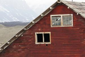 An Old Building with Broken Windows at the Abandoned Kennecott Copper Mine by Marc Moritsch