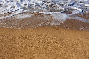 Gentle Ocean Surf Surging Onto a Golden Sand Beach by Marc Moritsch