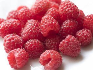 Ripe Red Raspberries on a Plate by Marc Moritsch