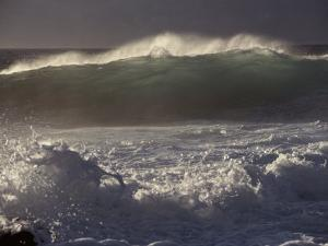 Surf Pounds a Beach in Hawaii by Marc Moritsch