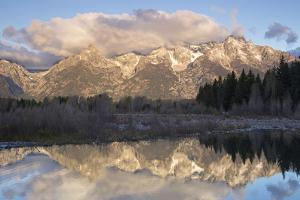 The Teton Range with Clouds Overhead, and Forests, Reflected in the Snake River by Marc Moritsch