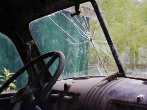 The View Inside an Abandoned Old Truck with a Broken Windshield by Marc Moritsch