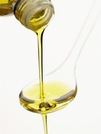 Pouring Olive Oil Over a Spoon