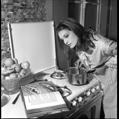 Dalida Ccooking in Her Kitchen