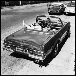 Luis Mariano and Annie Cordy Drinving a Cabriolet by Marcel Begoin