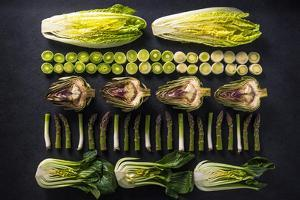 Green Vegetables Cut in Halves, Flat Lay Design on Dark Background, Symmetric by Marcin Jucha