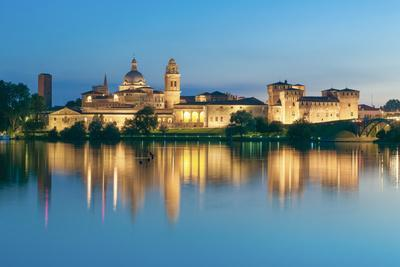 Mantova, Lombardy, Italy. Mincio's Banks with Historical Buildings at Sunset.
