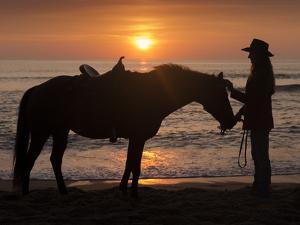 Horse and rider, sunrise, Vilano Beach, Florida by Maresa Pryor