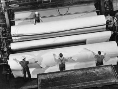 20 Ft. Roll of Finished Paper Arriving on the Rewinder, Ready to Be Cut and Shipped from Paper Mill