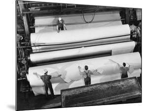 20 Ft. Roll of Finished Paper Arriving on the Rewinder, Ready to Be Cut and Shipped from Paper Mill by Margaret Bourke-White