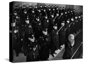 40 Uniformed Jersey City Police Officers Holding Nightsticks Erect Against Chest in a Salute by Margaret Bourke-White