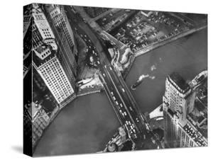 Aerial View of a Bridge Crossing a River Flowing Through the City by Margaret Bourke-White