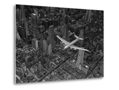 Aerial View of a DC-4 Passenger Plane Flying over Midtown Manhattan