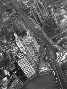Aerial View of Buildings and a Bridge Crossing a River Flowing Through the City by Margaret Bourke-White