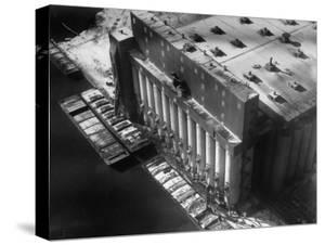Aerial View of Cargill Grain Elevator with Barges Lined up on the Bank of the Chicago River by Margaret Bourke-White