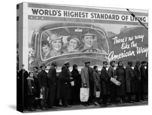 African American Flood Victims Lined Up to Get Food and Clothing From Red Cross Relief Station by Margaret Bourke-White