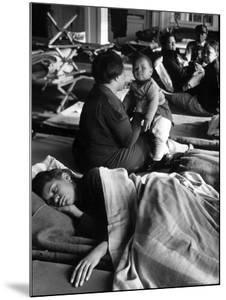 African American Refugees Left Homeless After Severe Flooding Sleep in Temporary Relief Station by Margaret Bourke-White