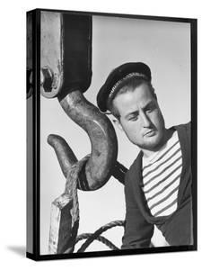 Algerian Sailor Raymond Cartaing, French Navy, Assembles Guns from America's Lend Lease Program by Margaret Bourke-White