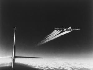 American B-36 Bomber Leaving Vapor Trails During High Altitude Flight over Carswell AFB by Margaret Bourke-White