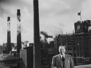 Anheuser Busch Heir Augusta. Busch Jr. Standing in Front of a Budweiser Brewery by Margaret Bourke-White