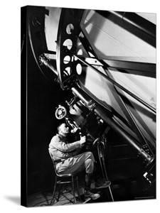 Astronomer Edwin Powell Hubble Looking Though Eyepiece of Telescope at Mt. Wilson Observatory by Margaret Bourke-White