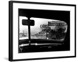 Baltimore Washington stretch of U.S. Highway is a clutter of signs through rain covered windshields by Margaret Bourke-White