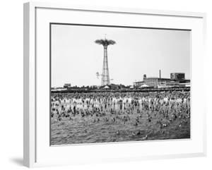 Bathers Enjoying Coney Island Beaches. Parachute Ride and Steeplechase Park Visible in the Rear by Margaret Bourke-White