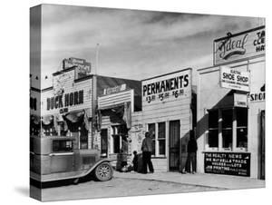 Beauty Parlor Advertising: Permanents: $3.50, $5.00 and $6.50, Shack Town, Fort Peck Dam by Margaret Bourke-White