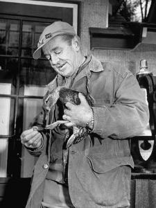 Brewing Scion August A. Busch, Jr. Banding Wounded Duck on His Family's Estate by Margaret Bourke-White