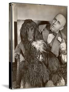 "Britain's Top Journalist Vladimir Poliakoff aka ""Augur,"" Posing with His Beloved Afghan Hound by Margaret Bourke-White"