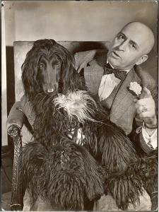 "Britain's Top Journalist Vladimir Poliakoff aka ""Augur,"" Posing with His Beloved Afghan Hound by Margaret Bourke-White"