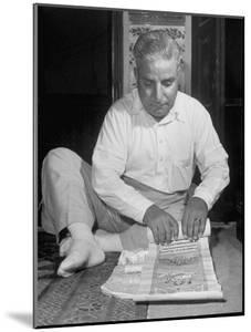 Broker Astrologer Reading Horoscope While Trading at Bombay Stock Exchange by Margaret Bourke-White
