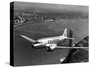 Canadian Colonial Airways Passenger Plane Flys over George Washington Bridge in Montreal, Canada by Margaret Bourke-White