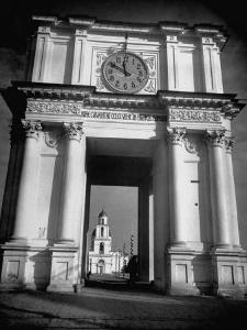 Cement Archway Featuring a Clock over the Entrance to the Grounds of the Greek Orthodox Church by Margaret Bourke-White