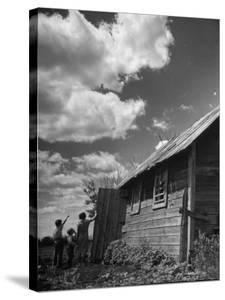 Children Searching the Sky Looking for Rain Clouds Outside Farmhouse During Drought in the Midwest by Margaret Bourke-White