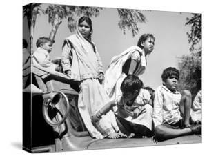 Children Watch Funeral Procession of Assassinated Indian Leader Mohandas K. Gandhi by Margaret Bourke-White