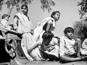 Children Watch Funeral Procession of Assassinated Indian Leader Mohandas K. Gandhi by Margaret Bourke-White