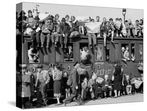 Civilians Packing Onto Overcrowded Train Leaving Postwar Berlin by Margaret Bourke-White