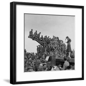 Comedienne Martha Raye on Stage for a Rapt Audience of Amer. Soldiers During USO-Camp Shows by Margaret Bourke-White